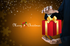 Smart hand showing the gift box Royalty Free Stock Photos