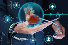 Smart hand showing human heart and stethoscope Stock Images
