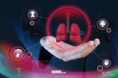 Smart hand showing human lungs Stock Photos