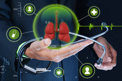 Smart hand showing human lungs and stethoscope royalty free stock images