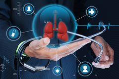 Smart hand showing human lungs and stethoscope royalty free stock photos