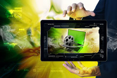 Smart hand showing Laptop with reel in frame Royalty Free Stock Image