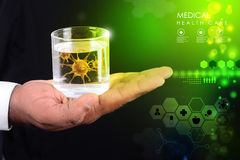 Smart hand showing virus in glass of water Stock Photos