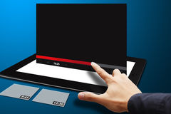Smart hand touch the VDO download bar on tablet Stock Photo