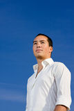 Smart handsome asian man looking forward Stock Photos