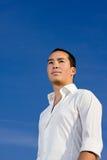 Smart handsome asian man looking forward Stock Photos