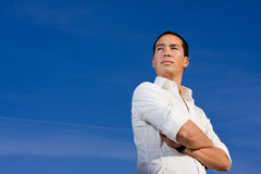 Smart handsome asian man looking forward Stock Photography
