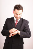 Smart handsome businessman checking time Stock Photo