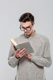 Smart handsome young man reading book Royalty Free Stock Photography