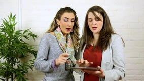 Smart happy smiling chatting women using ipad tablet app stock video
