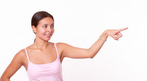 Smart hispanic girl pointing to her left Royalty Free Stock Photos