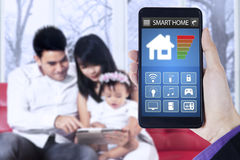 Smart home app and family in house stock photography