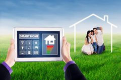 Smart home applications and cheerful family Royalty Free Stock Photography