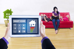 Smart home applications and happy family concept Stock Image