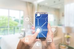 Smart home automation app on mobile with home interior in backgr. Ound. Internet of things concept at home. Smart technology 4.0 stock images