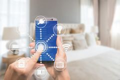 Smart home automation app on tablet with home interior in background. Internet of things concept royalty free stock photo