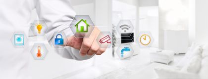 Free Smart Home Automation Hand Touch Screen With Colored Symbols On Royalty Free Stock Photos - 105195668