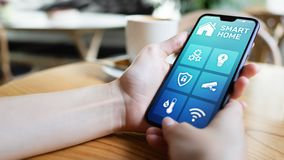 Smart home control application on mobile phone screen. Automation and iot concept. royalty free stock image