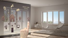 Smart home control concept, hand controlling digital interface from mobile app. Blurred background showing modern living room, arc. Hitecture interior design stock image
