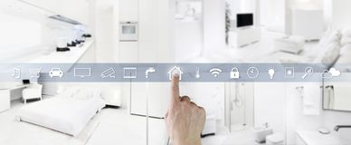 Smart home control concept hand touch icons screen with interiors, living room, kitchen, bedroom and bathroom on blurred. Smart home control concept hand icons royalty free stock photo