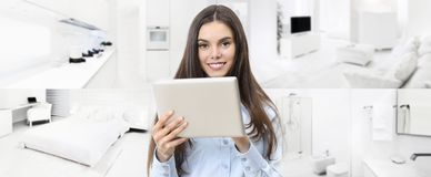 Smart home control concept smiling woman with digital tablet on. Interiors, living room, kitchen, bedroom and bathroom background stock image