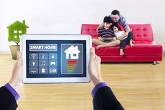 Smart home controller with children and dad Royalty Free Stock Photos