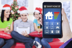 Smart home controller and three teenager Royalty Free Stock Photography