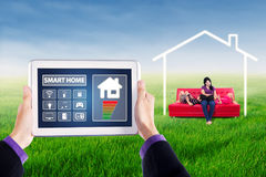 Smart home controller with woman and children Royalty Free Stock Images