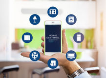 Smart Home Device - Home Control app on smartphone Stock Image