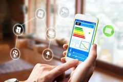 Smart Home Device - House automation home Control concept. Smart home, intelligent house automation remote control technology concept on smart phone / tablet stock photo