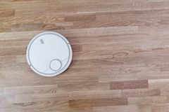 Smart home Robot vacuum cleaner on laminate floor, efficient dust absorption, automatic intelligent cleaning algorithm selection. System stock images