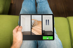 Smart home security system. On tablet Stock Photography