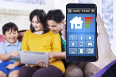 Smart home system and cheerful family at home Stock Photo
