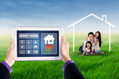 Smart home system and happy family Royalty Free Stock Photography