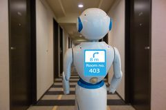 Smart hotel in hospitality industry 4.0 technology concept, robot butler robot assistant use for greet arriving guests, deliver. Customer, items to rooms, give stock photography