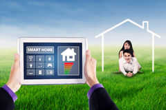Smart house controller and happy couple Stock Photo