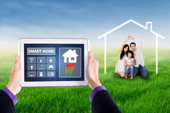 Smart house controller on tablet and happy family Stock Images