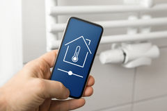 Smart house heating control. With app Stock Photos