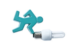 Smart idea concept. Blue stick man running with energy saving light bulb Stock Photography