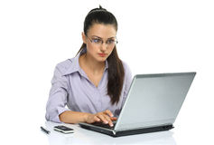 Smart and intelligence brunette!. Young business woman using laptop Stock Photos