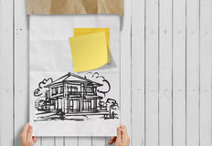 Smart investment  sticky note with house crumpled envelope Royalty Free Stock Image
