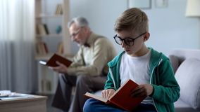 Smart kid in eyeglasses and old man reading books, education for different ages. Smart kid in eyeglasses and old men reading books, education for different ages stock image