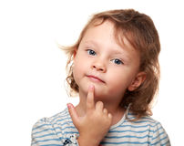 Smart kid girl thinking and holding finger Royalty Free Stock Photos