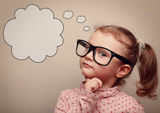 Smart kid in glasses thinking with speech bubble above. Vintage. Smart kid in glasses thinking with speech bubble above with empty copy space. Vintage portrait royalty free stock photo