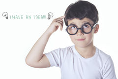 Smart kid. Having an idea stock photos