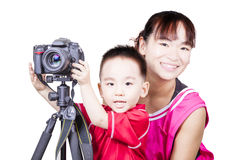 Smart kid with mother playing camera Royalty Free Stock Image