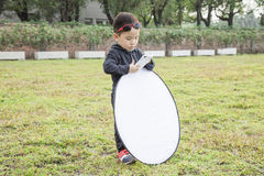 Smart kid photography assistant Royalty Free Stock Photography