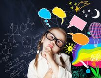 Smart kid with speech bubbles and colorful creative elements. Smart kid with speech bubbles and colorful creative design elements and science formulas on chalk royalty free stock photography