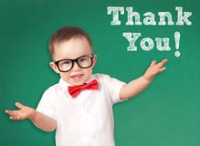 Smart Kid with a Thank You message. On a chalkboard royalty free stock images
