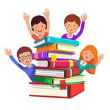 Smart kids waving hands from the book pile Royalty Free Stock Image